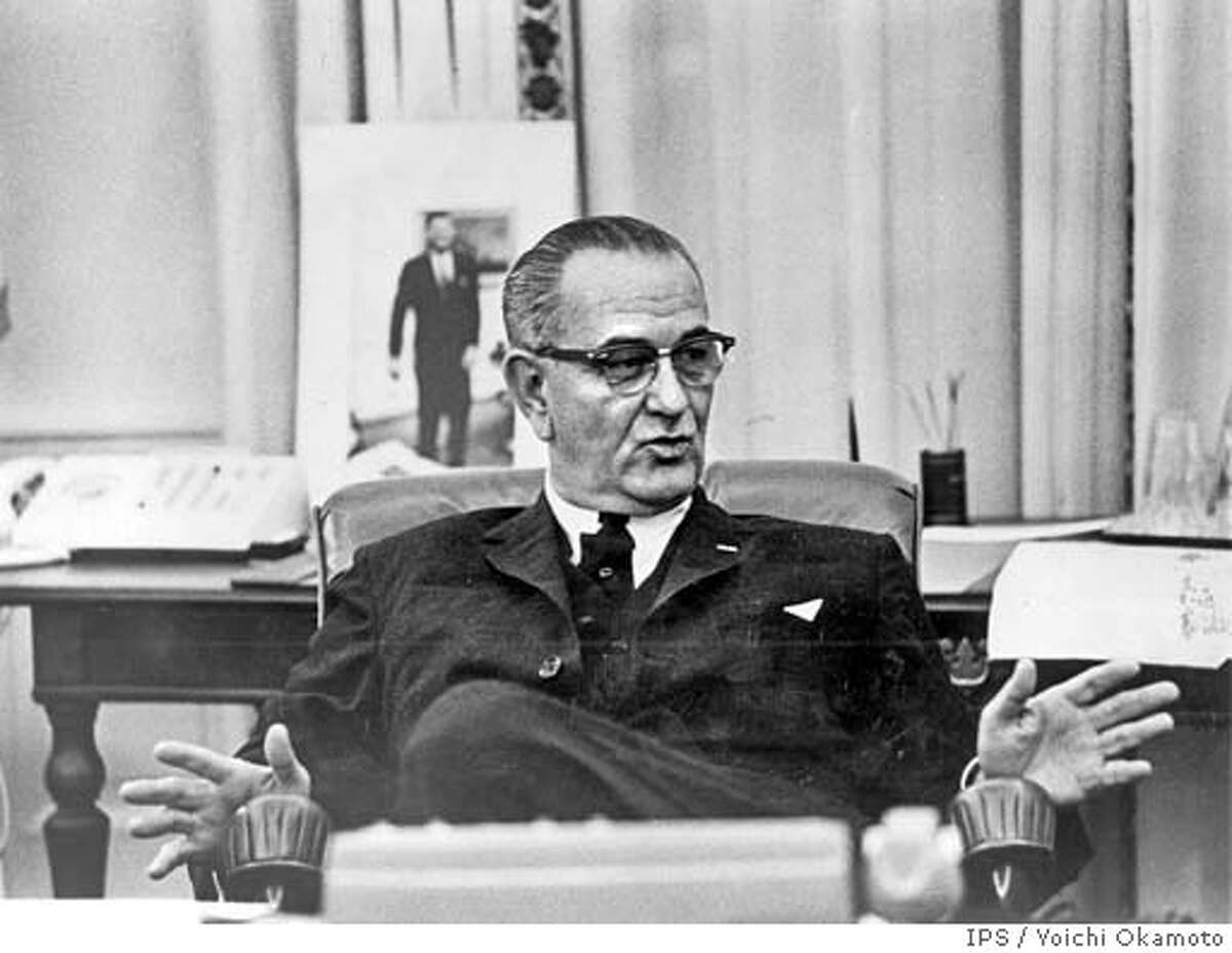 THIS IS A HANDOUT IMAGE. PLEASE VERIFY RIGHTS. DEPRESSION4-B-12MAR03-LV-HO A portrait of John F. Kennedy him, President Lyndon Johnson leans backin his big swivel chair, momentrarily relaxed. The phone is on the table behind. (IPS Photo by Yoichi Okamoto)