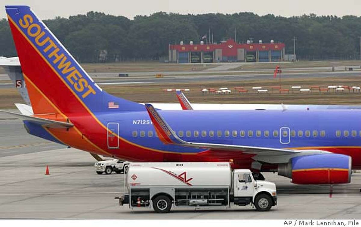 A Southwest Airlines jet is refueled at J.F. Green Airport in Warwick, R.I. Sunday, Aug. 21, 2005. Southwest Airlines Co. has joined the parade of carriers that are raising fares to help cover the rising cost of jet fuel. Retail gasoline prices are poised to jump to new highs this week as Hurricane Katrina barreled toward the heart of U.S. oil production and refining operations in the Gulf of Mexico on Monday, Aug. 29, 2005 sending crude-oil futures briefly above $70 a barrel for the first time. (AP Photo/Mark Lennihan)Ran on: 03-10-2006 Southwest Airlines and other low-cost carriers are being forced by rising fuel prices to raise their fares and limit deals.