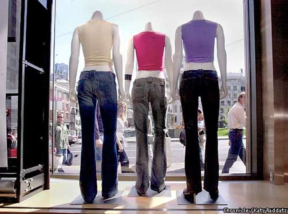 """PHOTO BY KATY RADDATZ--THE CHRONICLE  Low-waisted jeans helped Levi boost sales during the most recent quarter. We see hip-hugging styles for women and men all over the big Levi's store at Union Square. SHOWN: Mannequins in the front window wear """"Too Superlow"""" jeans. Photo: KATY RADDATZ"""
