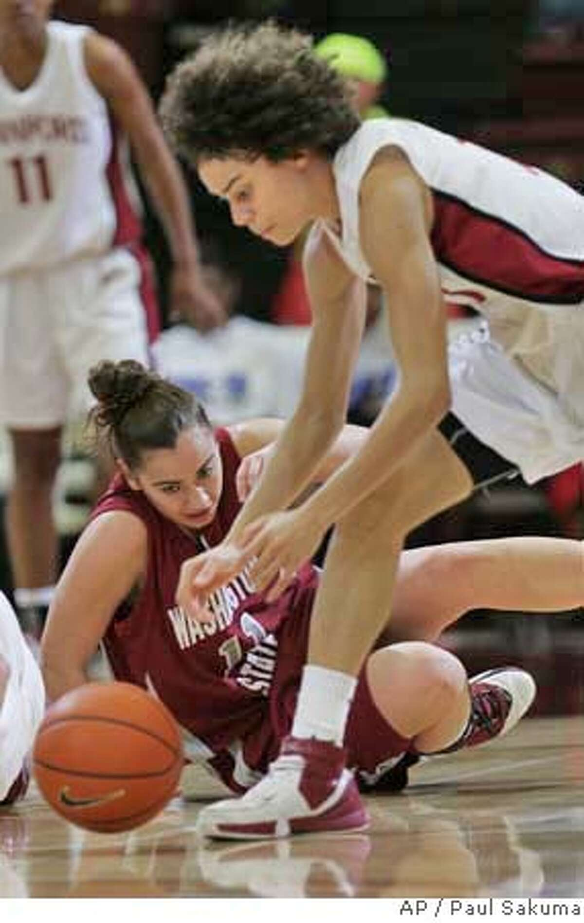 Stanford guard Cissy Pierce, right, gets the ball away from Washington State guard Colleen Betteridge, lower left, in the first half of their NCAA basketball game in Stanford, Calif., Thursday, Feb. 8, 2007. (AP Photo/Paul Sakuma)