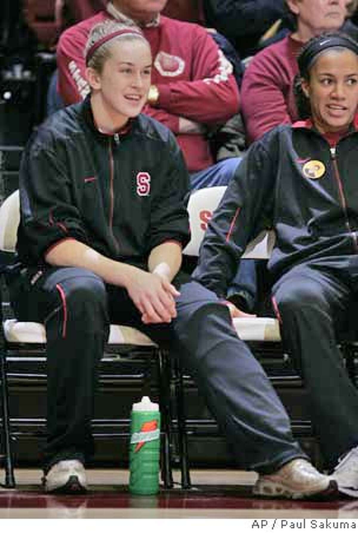Injured Stanford guard JJ Hones, left, and guard Rosalyn Gold-Onwude, right, sit on the bench in the first half against Washington State during their NCAA basketball game in Stanford, Calif., Thursday, Feb. 8, 2007. Hones injured her knee in the last game and is out for the rest of the season. Gold-Onwude has not played all season. (AP Photo/Paul Sakuma)