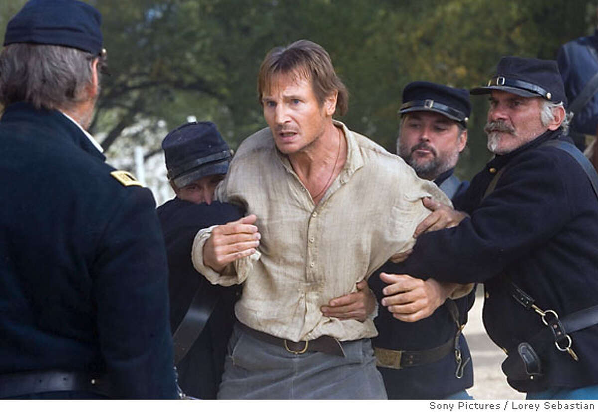 In this photo provided by International House of Publicity, Liam Neeson (center) stars in