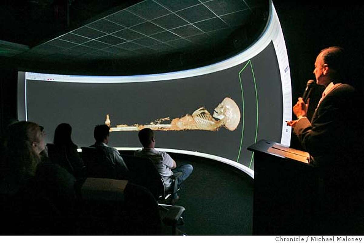 MUMMY_019_MJM.jpg Afshad Mistri, Advanced Visualization Marketeer for SGI (far right) shows a skeletal view of the 2,000 year old mummy. SGI (Silicon Graphics) showed the results of a 2,000 year old mummy scanned at Stanford in early May. The mummy is a child and was scanned at the Stanford University School of Medicine using an AXIOM Siemens scanner, one of only five CT scanners in the world capable of producing high resolution images. From these images and with the SGI's powerful computers, a realistic 3-D model was created allowing researchers a glimpse of the 2,000 year old mummy without disturbing it's delicate form. Photo by Michael Maloney / San Francisco Chronicle MANDATORY CREDIT FOR PHOTOG AND SF CHRONICLE/ -MAGS OUT