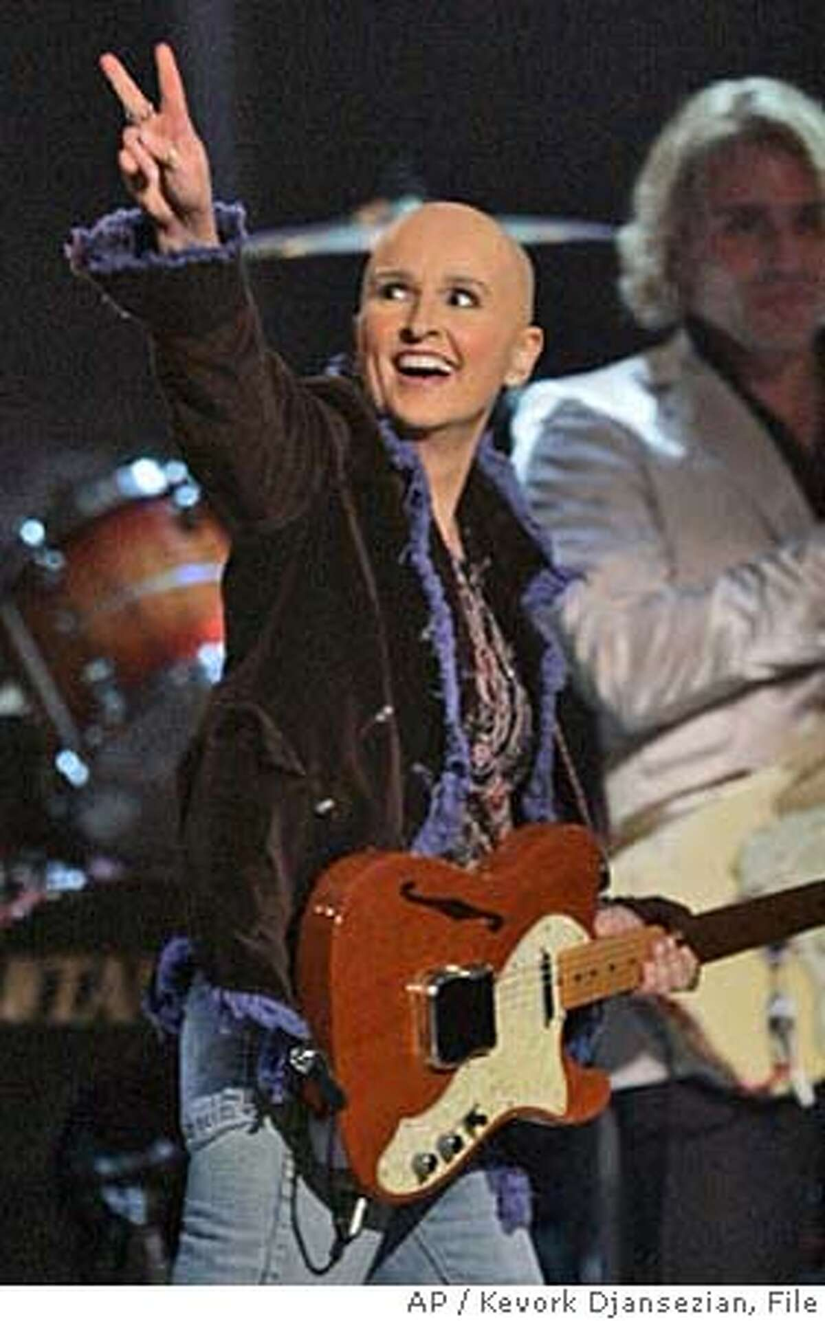 **FILE**Melissa Etheridge gestures after performing the medley
