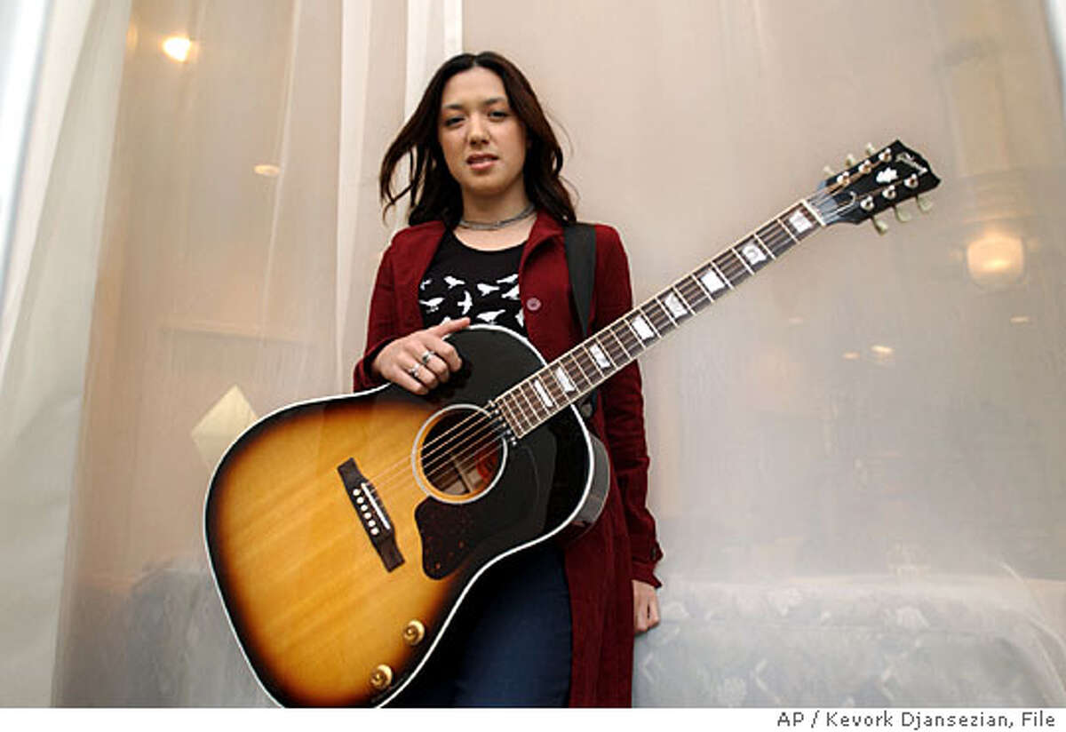 ** ADVANCE FOR WEEKEND EDITIONS, JULY 25-28 **Singer Michelle Branch poses with her guitar at the Argyle Hotel in West Hollywood, Calif., Oct. 19, 2001. A new crop of female singer-songwriters like Branch are challenging the notion that you have to bare your navel and cavort around in tight clothes to be sexy. Over the last year, artists like Pink, Branch, Vanessa Carlton and Avril Lavigne have been dominating the charts with by putting the focus on their music, and not their looks. (AP Photo/Kevork Djansezian) ALSO RAN 01/03/03