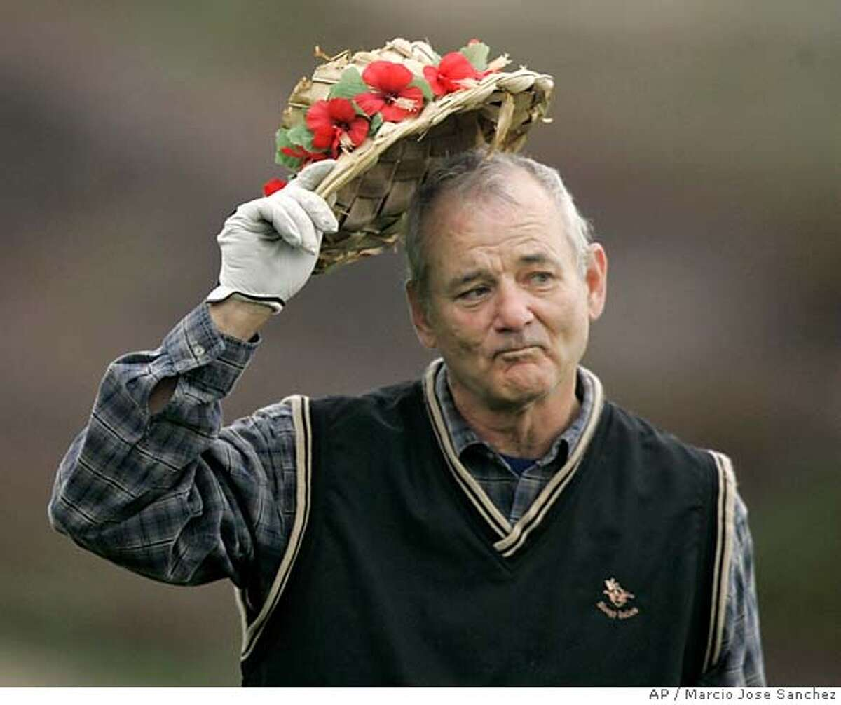 Actor Bill Murray tips his hat to the gallery during the first round of Pebble Beach National Pro Am at the Spyglass Hill golf course in Pebble Beach, Calif., Thursday, Feb. 8, 2007.(AP Photo/Marcio Jose Sanchez)
