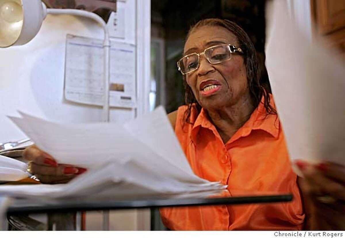 Jessie Macon who's son Edwin Macon Jr died in SFPD custody on july 1 2005.He had a heart problem . Jessie looks through the paper work about the death of her son. JAILDEATH_0060_kr.JPG 8/2/05 in DALY CITY,CA. KURT ROGERS/THE CHRONICLE MANDATORY CREDIT FOR PHOTOG AND SF CHRONICLE/ -MAGS OUT