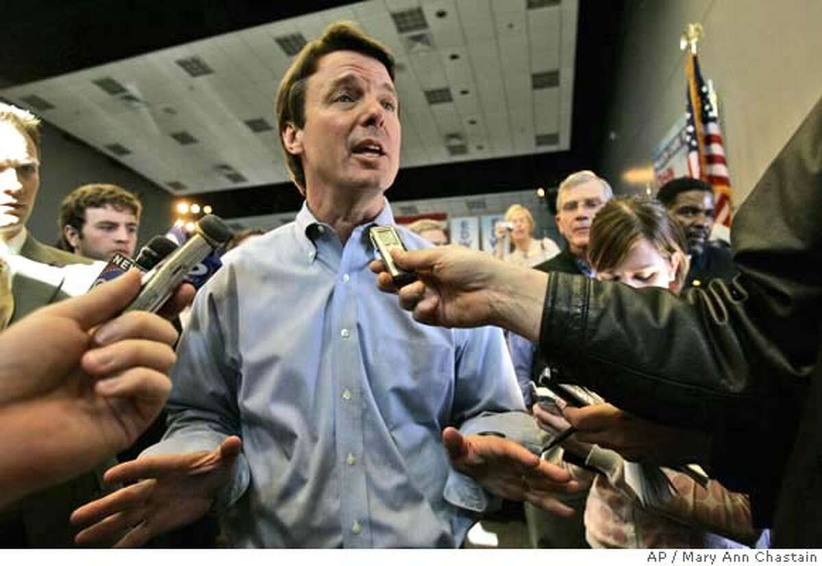 Democratic presidential hopeful John Edwards answers questions about bloggers he hired for his campaign after holding a town hall meeting on health care Thursday, Feb. 8, 2007, at the International Longshoremens Association Union Hall in Charleston, S.C. (AP Photo/Mary Ann Chastain)