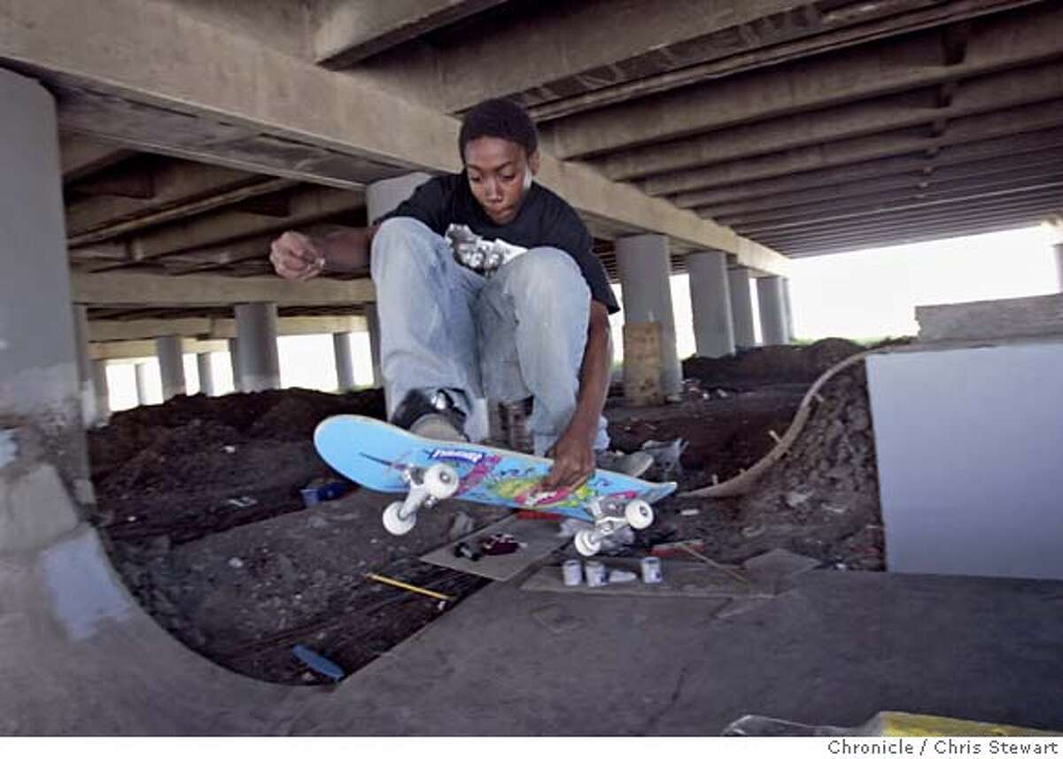 skatepark030314.jpg Event on 8/2/05 in Oakland. D'ontae Smith, 15, of Oakland gets air in a skate park that a group of skateboarders have for over a year been building in an undeveloped stretch of land beneath an elevated section of Interstate 580 in West Oakland. Using their own money and labor the group has moved tons of earth and brick to create the park. But Caltrans posted fliers at the site saying they were going to demolish the skate park Wednesday, August 3, 2005. The land had been used by drug dealers, drug users and homeless people, and nearby businesses applauded the new park. Chris Stewart / The Chronicle MANDATORY CREDIT FOR PHOTOG AND SF CHRONICLE/ -MAGS OUT
