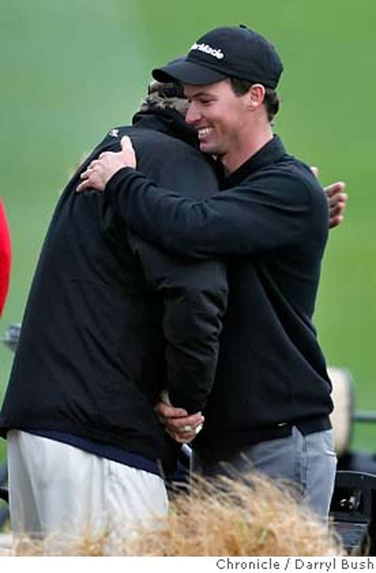 AT&Tgolf_0011_db.JPG Golfer John Mallinger (co-leader) hugs his father, Joe Mallinger after his round as he walks off the 9th green (his 18th hole), during the 1st round, at the 2007 AT&T Pebble Beach National Pro-Am at Pebble Beach Golf Links in Pebble Beach, CA, on Thursday, February, 8, 2007. photo taken: 2/8/07 Darryl Bush / The Chronicle ** (cq) MANDATORY CREDIT FOR PHOTOG AND SF CHRONICLE/ -MAGS OUT