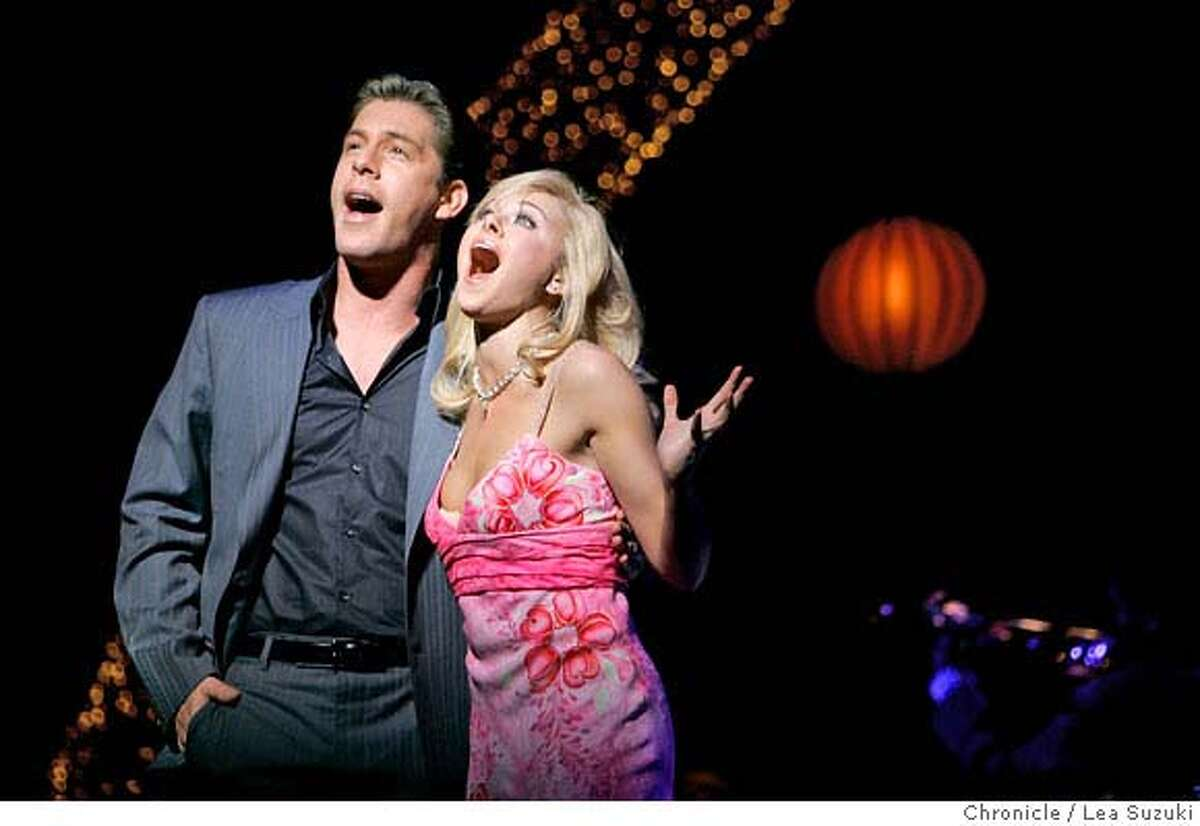 .jpg from right: : Laura Bell Bundy as Elle Woods and Warner played by Richard H. Blake in a scene where Elle anticipates a marriage proposal in Act 1. Dress rehearsal for Broadway-bound musical