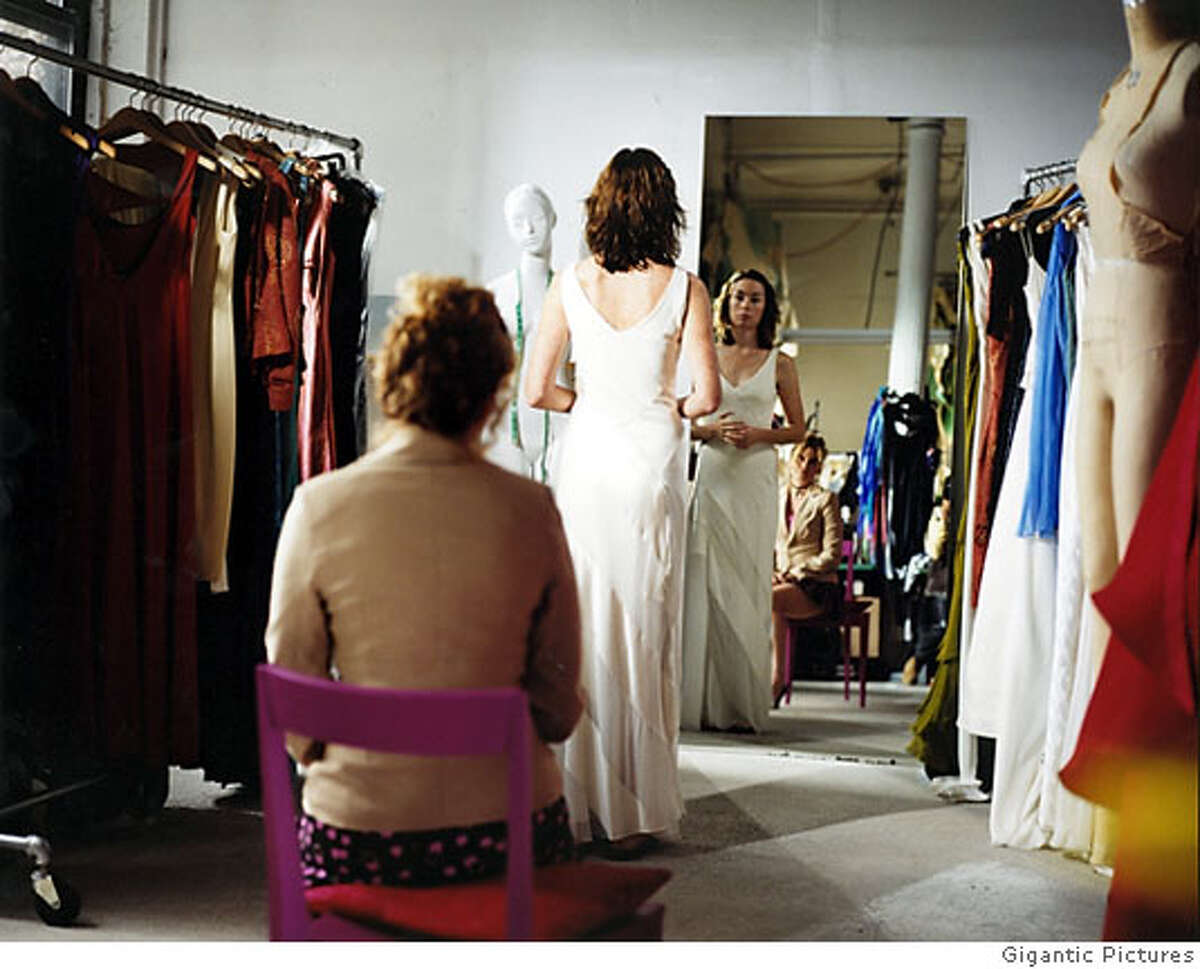 Nicole (Julianne Nicholson) is fitted for a wedding gown while her friend Tess (CHELSEA ALTMAN) critiques in a scene from Jeff Lipsky's romantic drama,