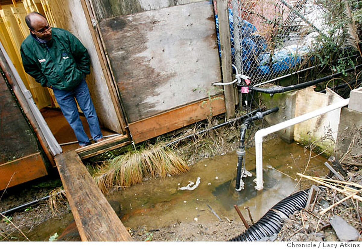 Martin Coleman, manager of Goodmans Lumber, checks behind the store at one of the 12 pumps they have ready for the heavy rains, Thursday FFeb. 8, 2006, in Mill Valley, Ca. Goodmans Lumber has had 5 major floods in the 26 years that Coleman has work for the company. (Lacy Atkins San Francisco Chronicle)