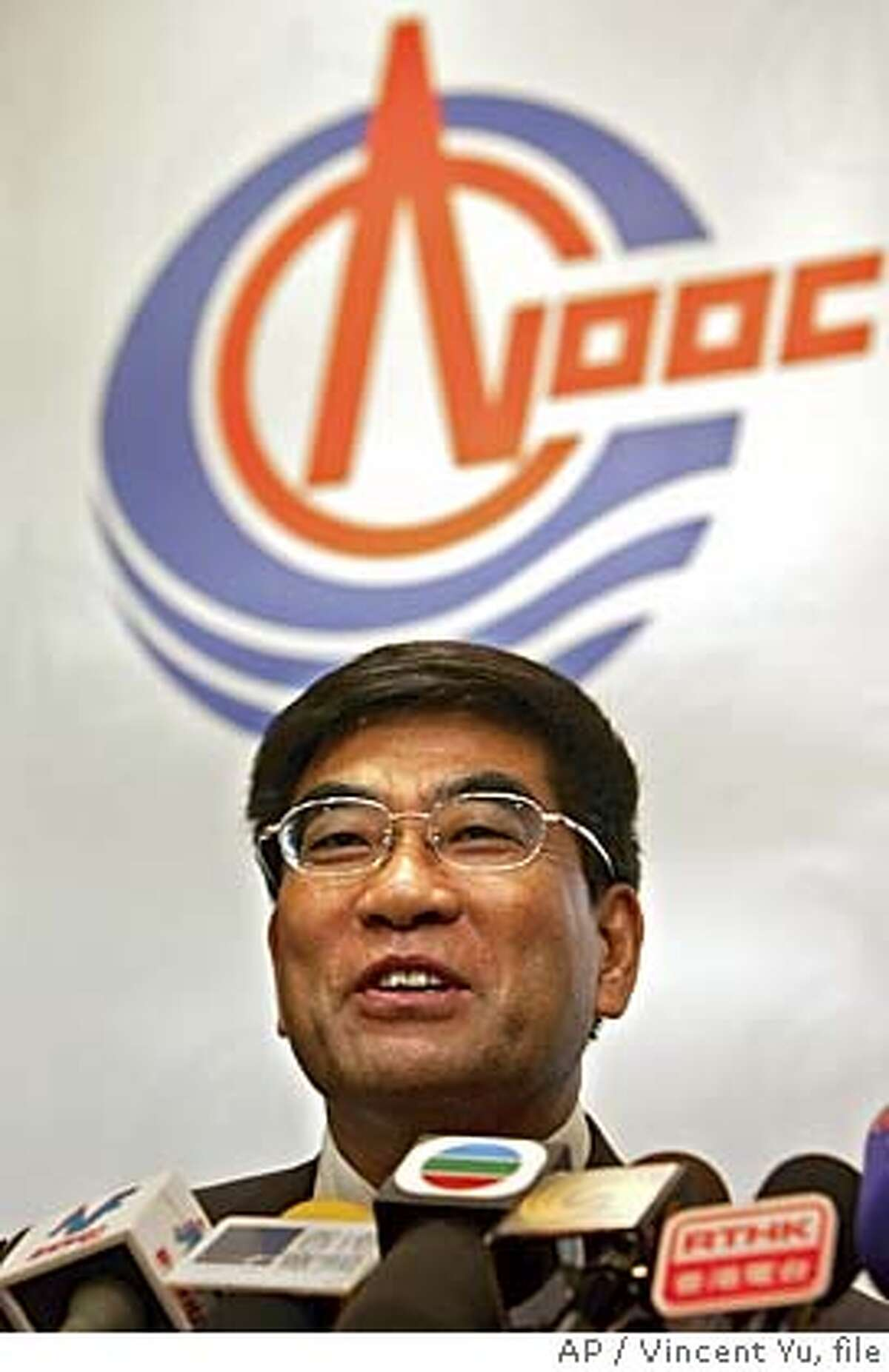 **FILE** Chairman and Chief Executive officer of China National Offshore Oil Corporation ( CNOOC ) Fu Chengyu smiles as he speaks to reporters during a press conference in Hong Kong in this Tuesday, March 29, 2005 file photo. Unocal Corp. said Monday, July 25, 2005 that it was prepared to drop its support for a takeover agreement with Chevron Corp. and accept an acquisition by CNOOC Ltd. had the Chinese state-owned oil company raised its bid sufficiently enough to offset regulatory and financial risks. (AP Photo/Vincent Yu, file) MARCH 29, 2005 FILE PHOTO