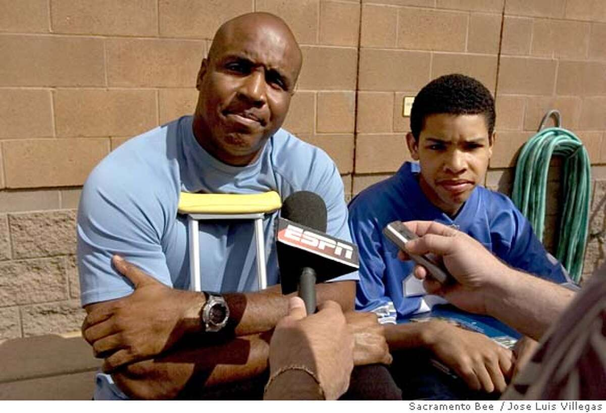 With his son, Nikolai, at his side, Barry Bonds speaks with the media at Scottsdale Stadium in Scottsdale, Ariz. Tuesday, March 22, 2005. Coming off knee surgery and caught up in baseball's steroids scandal, Bonds said he may not play at all this season. He also said he was physically and mentally