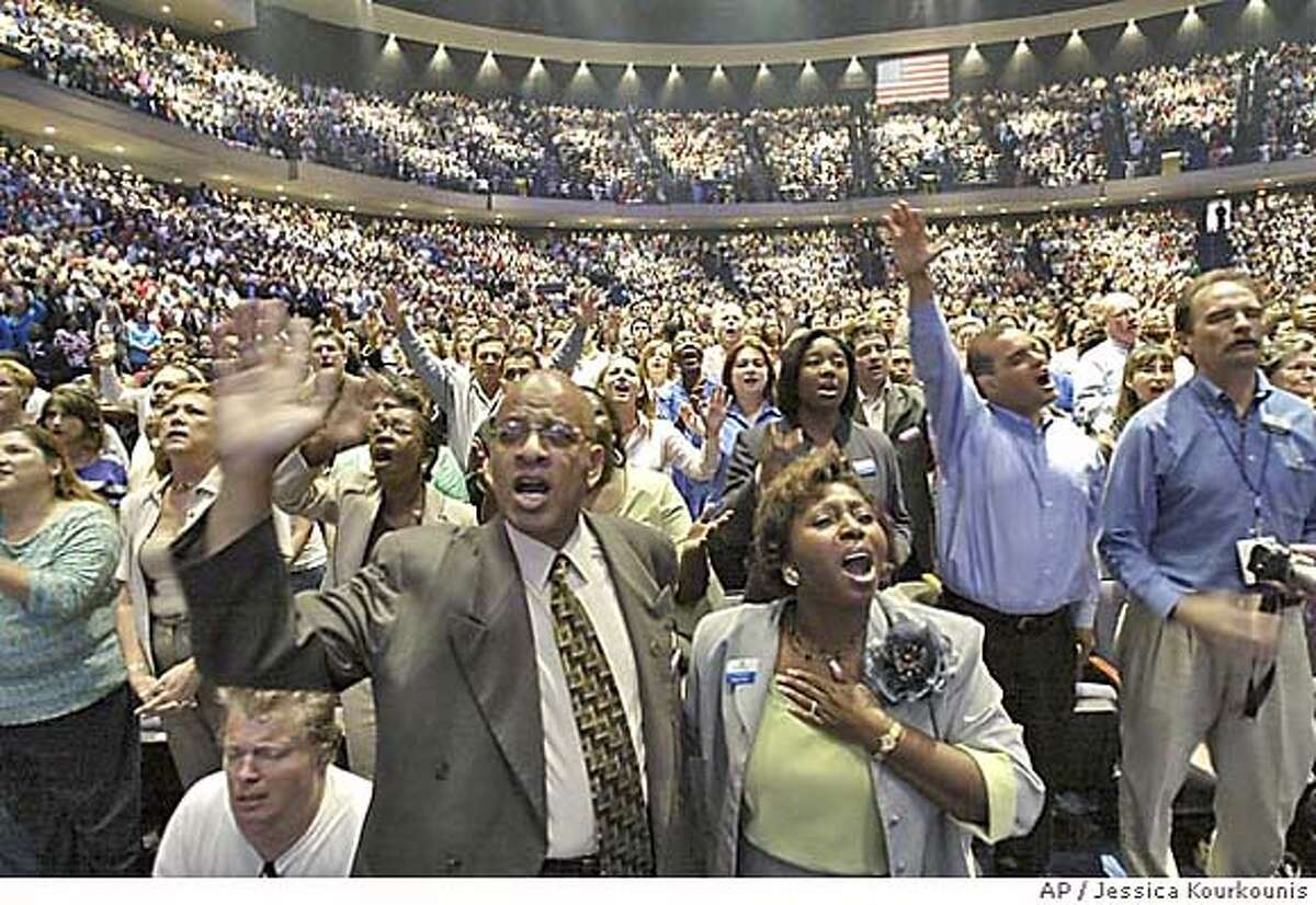 Members of the Lakewood Church along with first time visitors worship Saturday, July 16, 2005 at the grand opening of the new facility in Houston. The Lakewood Church, led by televangelist and best-selling author, Joel Osteen, officially opened the doors of the new building, formerly the Compaq Center, home of the Houston Rockets. The Lakewood Church Central Campus took 15 months and approximately $75 million to complete and will seat 16,000 people. AP Photo by Jessica Kourkounis