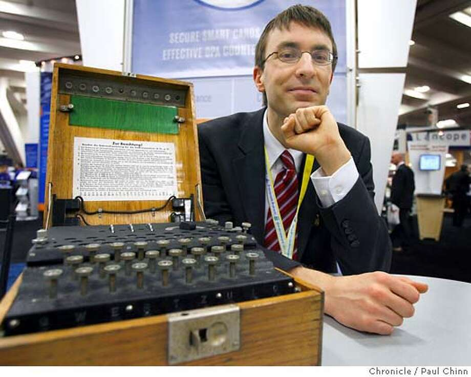 Paul Kocher displays a World War II-era Enigma cipher machine at the annual RSA Conference at Moscone Center in San Francisco, Calif. on Tuesday, Feb. 6, 2007. Kocher is president of Cryptography Research, Inc. which is developing encryption security for high definition DVD players. The Enigma was used by the German military to encrypt their communications until it was eventually cracked by Allied forces.  PAUL CHINN/The Chronicle  **Paul Kocher MANDATORY CREDIT FOR PHOTOGRAPHER AND S.F. CHRONICLE/ - MAGS OUT Photo: PAUL CHINN