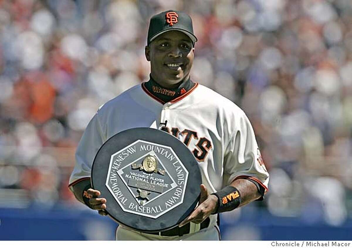 giants_087_mac.jpg Barry Bonds holds his National League MVP award for the fans to see. Opening day of the 2005 baseball season for the San Francisco Giants. The Giants take on the Los Angeles Dodgers. 4/5/05 San Francisco, Ca Michael Macor / San Francisco Chronicle Mandatory Credit for Photographer and San Francisco Chronicle/ - Magazine Out