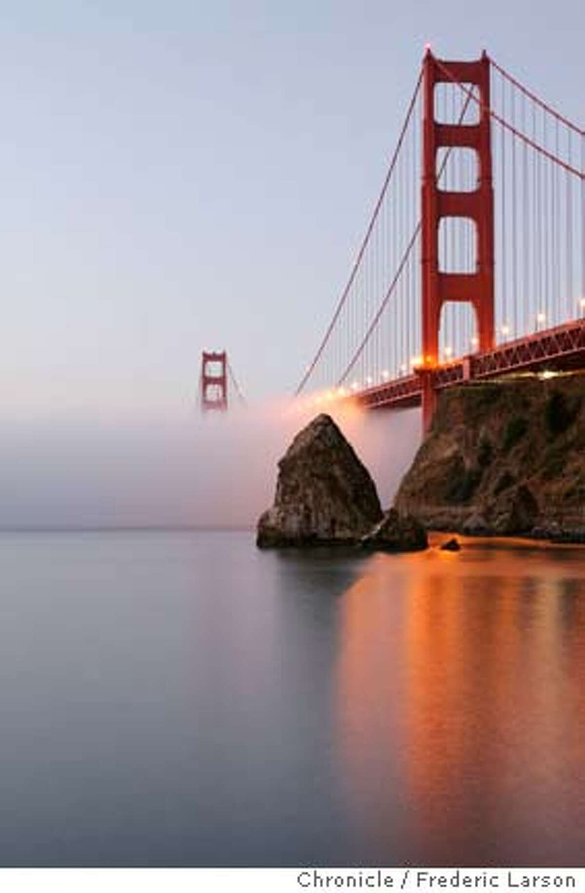 The September low hugging fog slowly makes its way under the Golden Gate Bridge seen at Fort Baker during sunrise. 9/12/06 {Frederic Larson/ The Chronicle} Ran on: 11-16-2006 The Golden Gate Bridge operates at a loss, largely due to security. Ran on: 11-16-2006 The Golden Gate Bridge towers above the fog at sunrise. Ran on: 11-16-2006