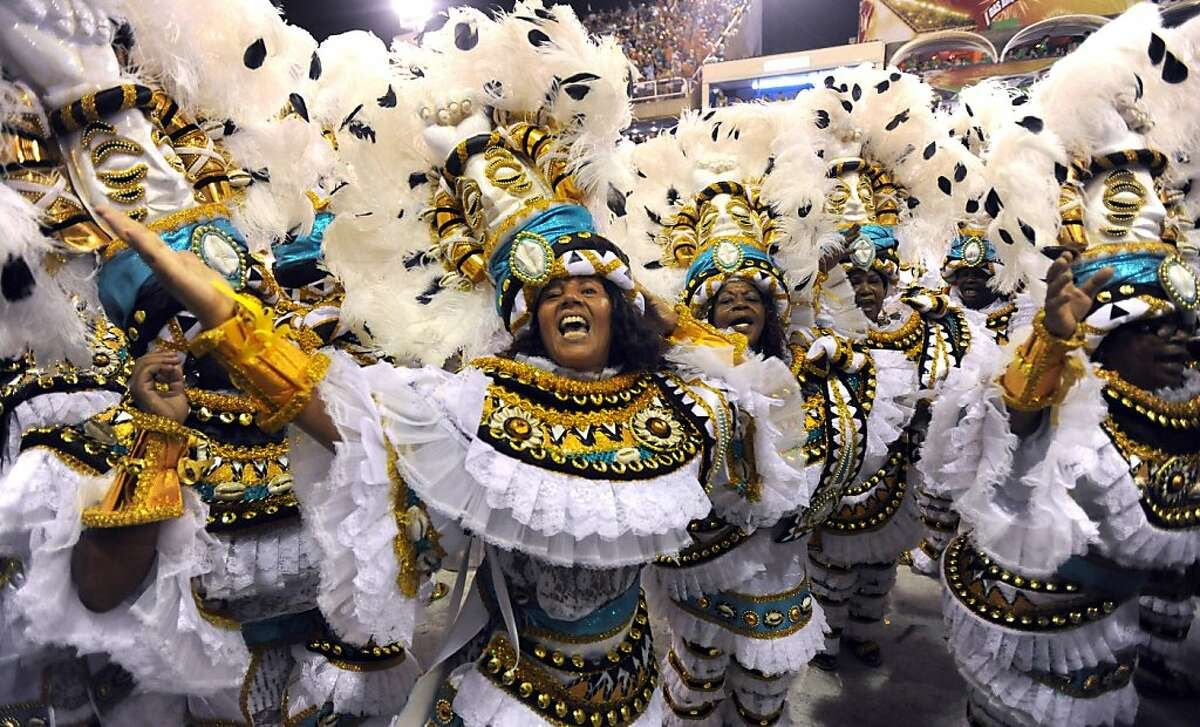 Revellers of the Villa Isabel samba school perform at the Sambodrome during the second night of Rio de Janeiro's famed Carnival on February 16, 2010. A child samba queen who broke down in tears as she fitfully paraded in the harsh glare of the media, andtwo killings during festivities, marred the climax of Rio's famed Carnival on February 15.