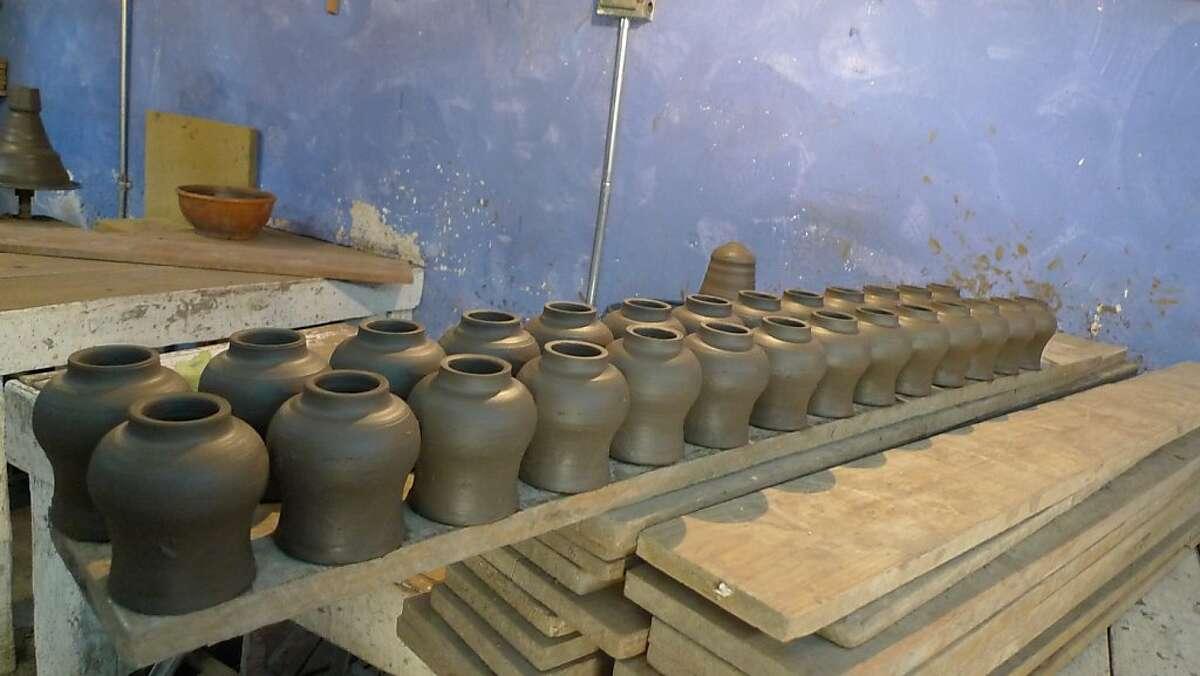 Talavera pottery ready for first bake at Uriarte Talavera in Puebla, Mexico.