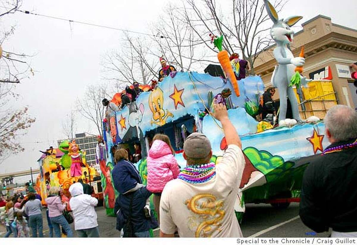 TRAVEL MARDI GRAS -- Young and old parade goers greet a float with cartoon characters in a 2006 Mardi Gras parade on St. Charles Street in New Orleans. Photo: Craig Guillot / Special to the Chronicle One-time print; OK for SFGate use