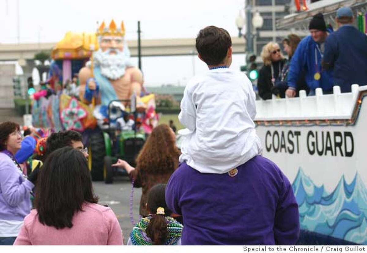 TRAVEL MARDI GRAS -- Parents and children watch the 2006 Mardi Gras Festival and Parade in New Orleans on St. Charles St. Photo: Craig Guillot / Special to the Chronicle 2006 One-time print; OK for SFGate use