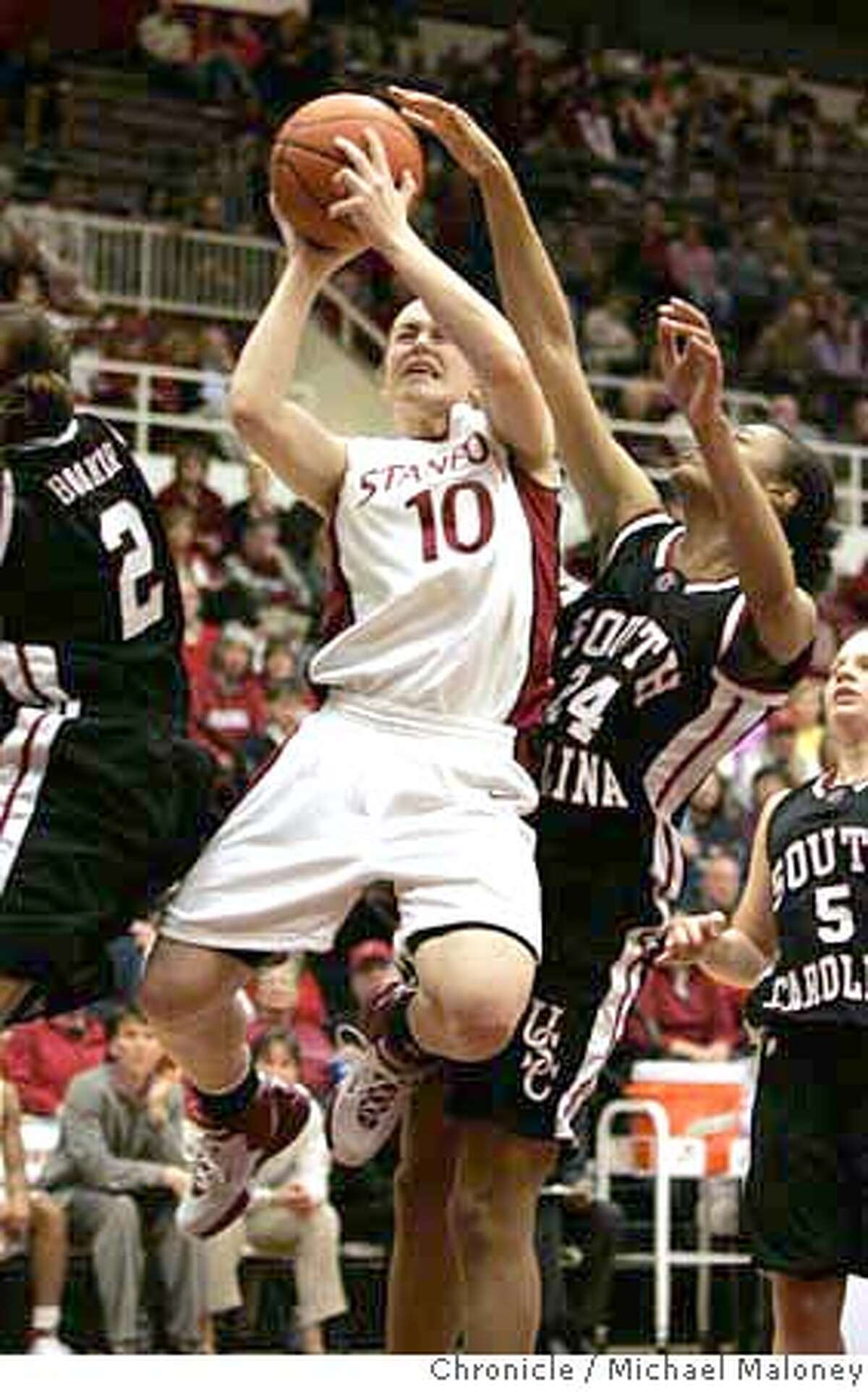 Stanford's #10 JJ Hones goes up for a shot against South Carolina's #24 Demetress Adams in the 2nd period. Stanford Cardinal (women) vs. South Carolina Gamecocks at Maples Pavillion at Stanford. Photo taken on 1/8/07 by Michael Maloney / San Francisco Chronicle MANDATORY CREDIT FOR PHOTOG AND SF CHRONICLE/ -MAGS OUT