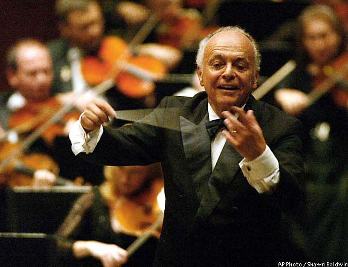 Lorin Maazel conducts Beethoven's Ninth Symphony during his debut as the New York Philharmonic's music director in 2002. Associated Press photo by Shawn Baldwin
