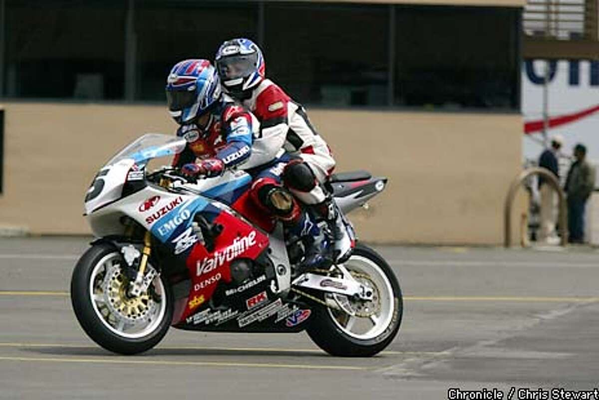 Steve Rapp, who was raised in Lafayette and graduated from Acalanes High School, now races motorcycles for Team Valvoline EMGO Suzuki. To kick off the AMA Supercuts Superbike Challenge at Infineon Raceway at Sears Point May 2-4, Rapp took brave media types around the track Thursday, May 1, 2003, on a custom-built GSX-R1000 race bike with a dual seat. CHRIS STEWART / THE CHRONICLE