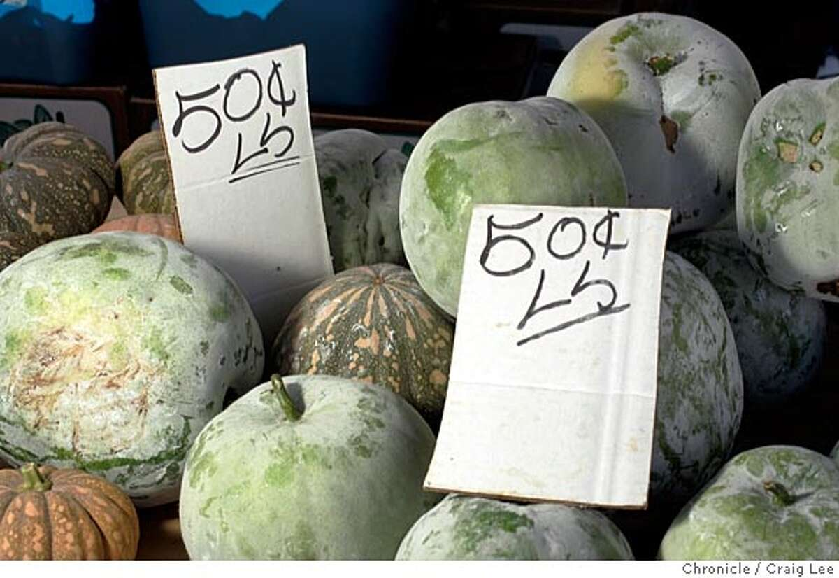 Photo of Winter Melon. The Xiong family, Hmong tribal people from Laos. This family is from Fresno and drive to San Francisco every Saturday to sell their produce at the Alemany farmers market. Event on 7/23/05 in San Francisco. Craig Lee / The Chronicle
