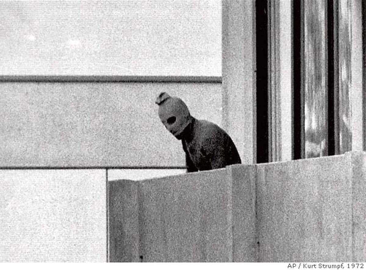 FILE--A member of the Arab Commando group which seized members of the Israeli Olympic Team at their quarters at the Munich Olympic Village in this Sept. 5, 1972 photo. Munich's frightening image of hooded terrorists holding Israeli athletes hostage. Atlanta's bomb in Centennial Park. Olympics are hardly strangers to violence and terrorism. Now, before a single snowflake falls in the mountains outside Salt Lake City, the threat of violence suddenly looms for the 2002 Winter Games. (AP Photo/Kurt Strumpf) ALSO RAN 02/06/02, 09/06/02 CAT A Sept. 5, 1972 file photo