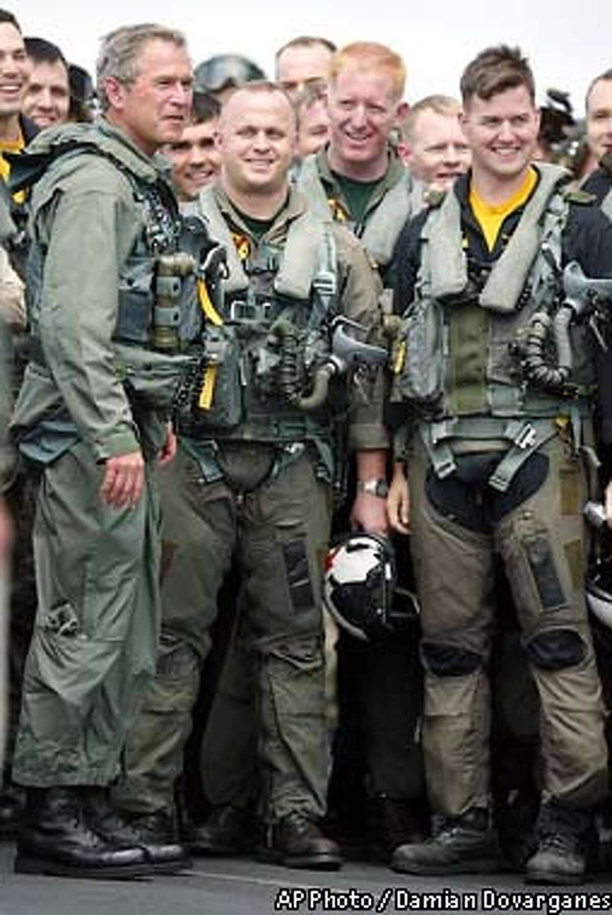 President Bush pauses for a photo Thursday, May 1, 2003, with pilots from Squadron VFA,