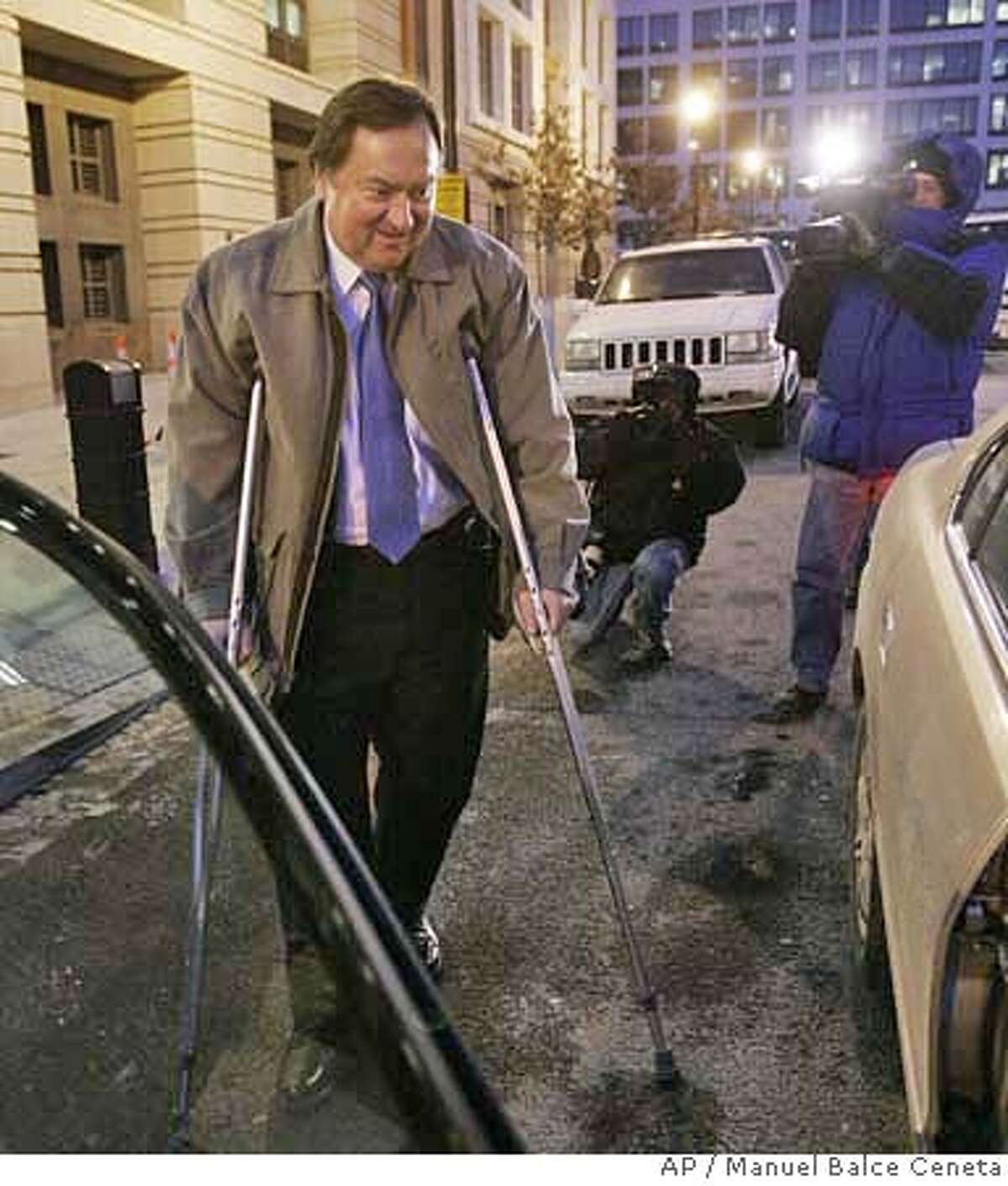 Tim Russert, Washington bureau chief of NBC News, walks with the aid of crutches as he leaves U.S. Federal Court, Thursday, Feb. 7, 2007, in Washington. Russert is key prosecution witness in the I Lewis