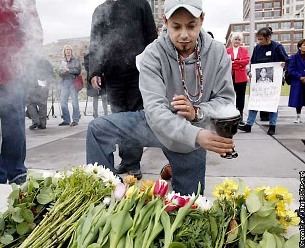 Gustavo Cravioto conducts a purification ceremony with burning resin over flowers that are to be tossed in the bay as he joined friends and family of Evelyn Hernandez holding a vigil today, Friday, May 2, 2003 on the Embarcadero near where her body was found nearly a year ago. Hernandez was pregnant when she disappeared around May 1, 2002 with her son Alex, 5. Alex and her full term fetus are still missing. CHRIS STEWART / THE CHRONICLE