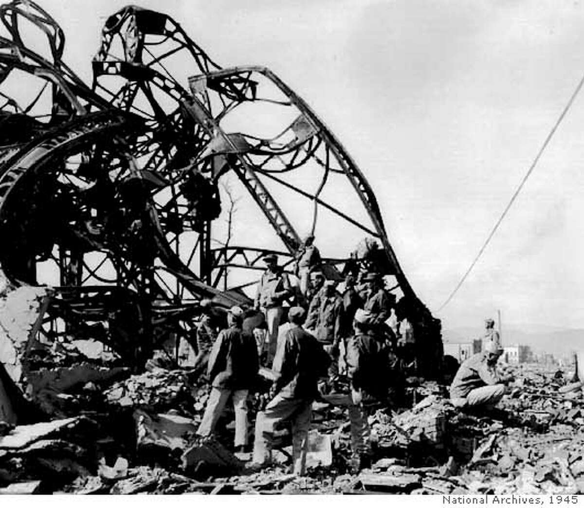 GIs of the 99th Signal Battalion in Hiroshima look at the steel skeleton of a building destroyed by the atomic bomb on Aug. 6, 1945. Saturday will mark the 60th anniversary of the dropping of the bomb on Hiroshima. National Archives Photo, 1945