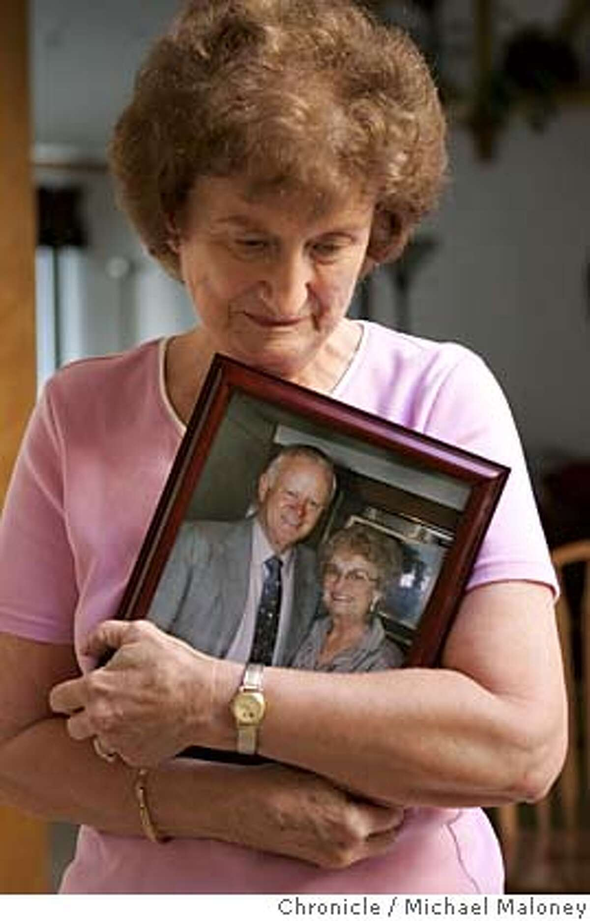 NEVIUS02_023_MJM.jpg Joyce Brooks of Livermore holds on to a portrait of her and her deceased husband Carl Brooks. Carl was a machinist at Lawrence Livermore Lab and was exposed to beryllium during his work. He died in January 2000 of beryllium disease, a form of lung cancer. Former Livermore lab workers and surviving spouses of those who died talk about the anguishing process of getting the federal government to acknowledge their claims that handling nuclear materials decades ago made them sick. Four years after a federal law allowed workers to file claims, many of them have not received a cent. Joyce Brooks, is one of the lucky ones. Photo by Michael Maloney / San Francisco Chronicle MANDATORY CREDIT FOR PHOTOG AND SF CHRONICLE/ -MAGS OUT