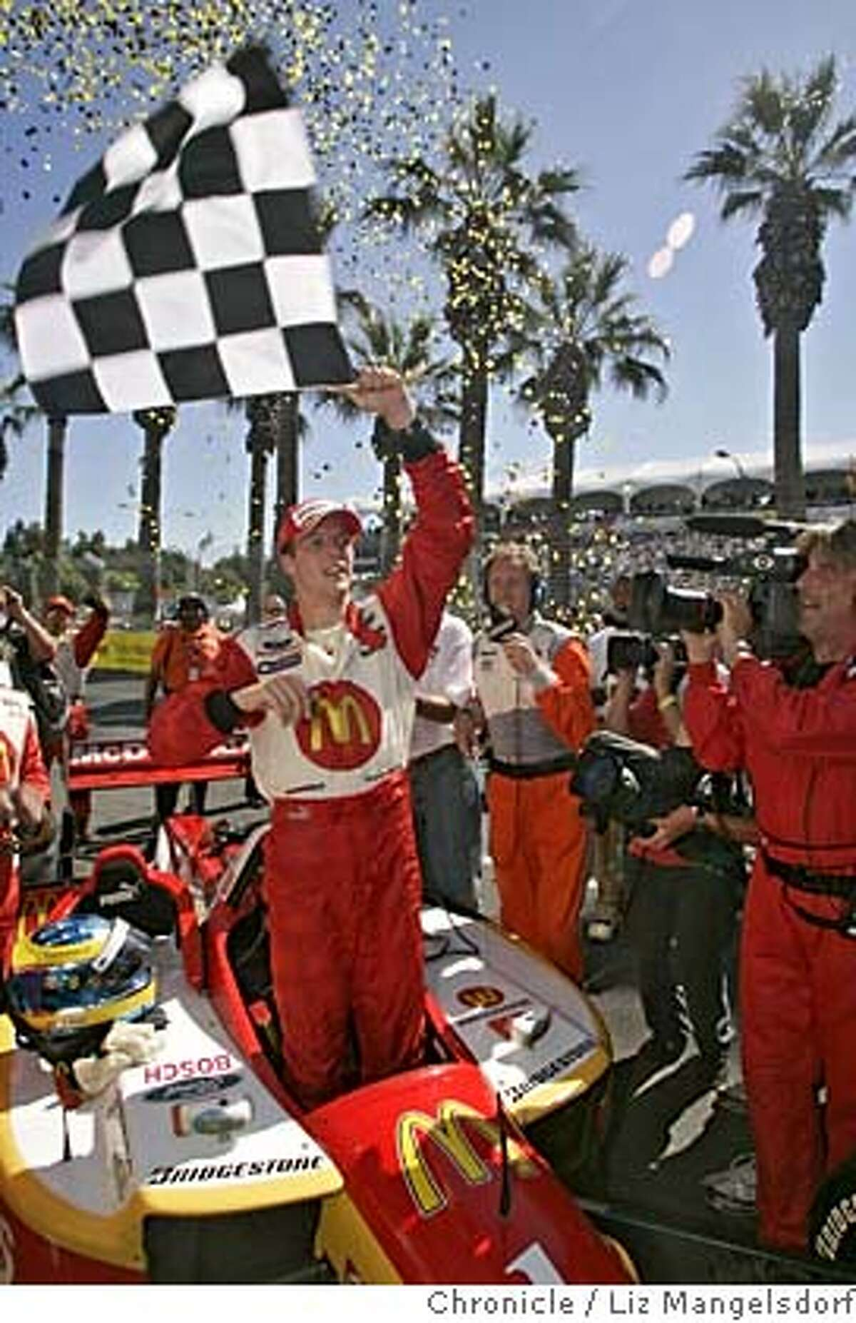champ01_356_lm.JPG Event on 7/31/05 in San Jose. Winner Sebastien Bourdais waves a flag after winning the Grand Prix of San Jose. The Taylor Woodrow Grand Prix of San Jose, run through the streets of downtown San Jose. Liz Mangelsdorf / The Chronicle MANDATORY CREDIT FOR PHOTOG AND SF CHRONICLE/ -MAGS OUT