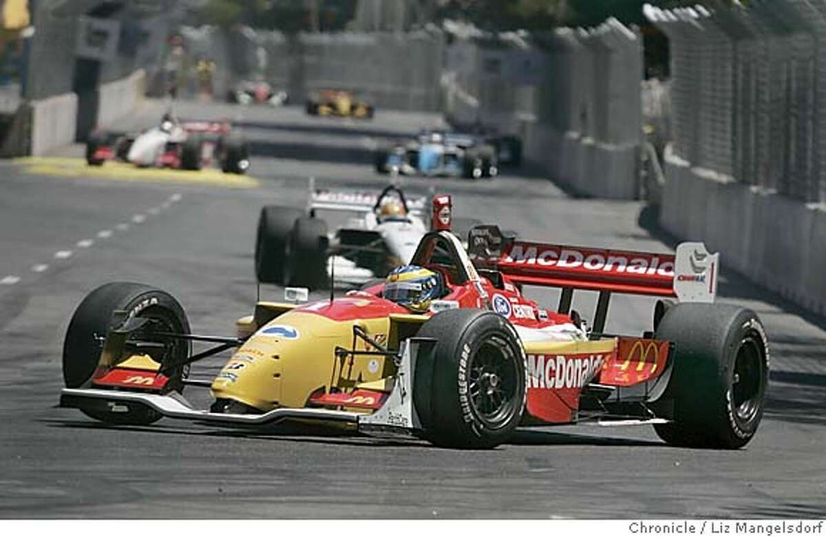 champ01_151_lm.JPG Event on 7/31/05 in San Jose. Winner Sebastien Bourdais leads early in the race. Here he takes the hairpin turn on Almaden Blvd. The Taylor Woodrow Grand Prix of San Jose, run through the streets of downtown San Jose. Liz Mangelsdorf / The Chronicle MANDATORY CREDIT FOR PHOTOG AND SF CHRONICLE/ -MAGS OUT