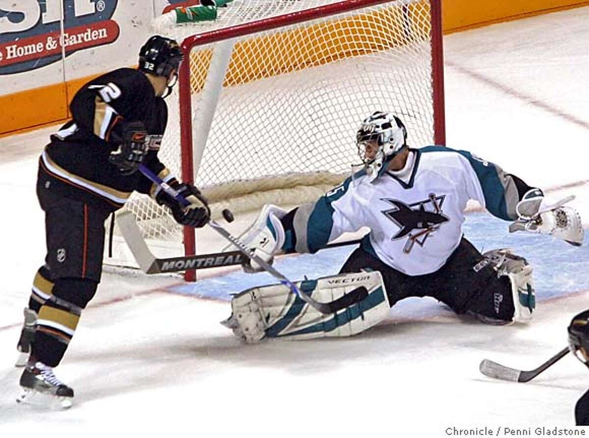 San Jose Sharks vs Anaheim Ducks at HP Pavilion Sharks goaltender Vesa Toskala stops a puck shot by the Ducks. Duck Travis Moen at left who made their first goal. Event on 2/6/07 in San Jose. penni gladstone / The Chronicle