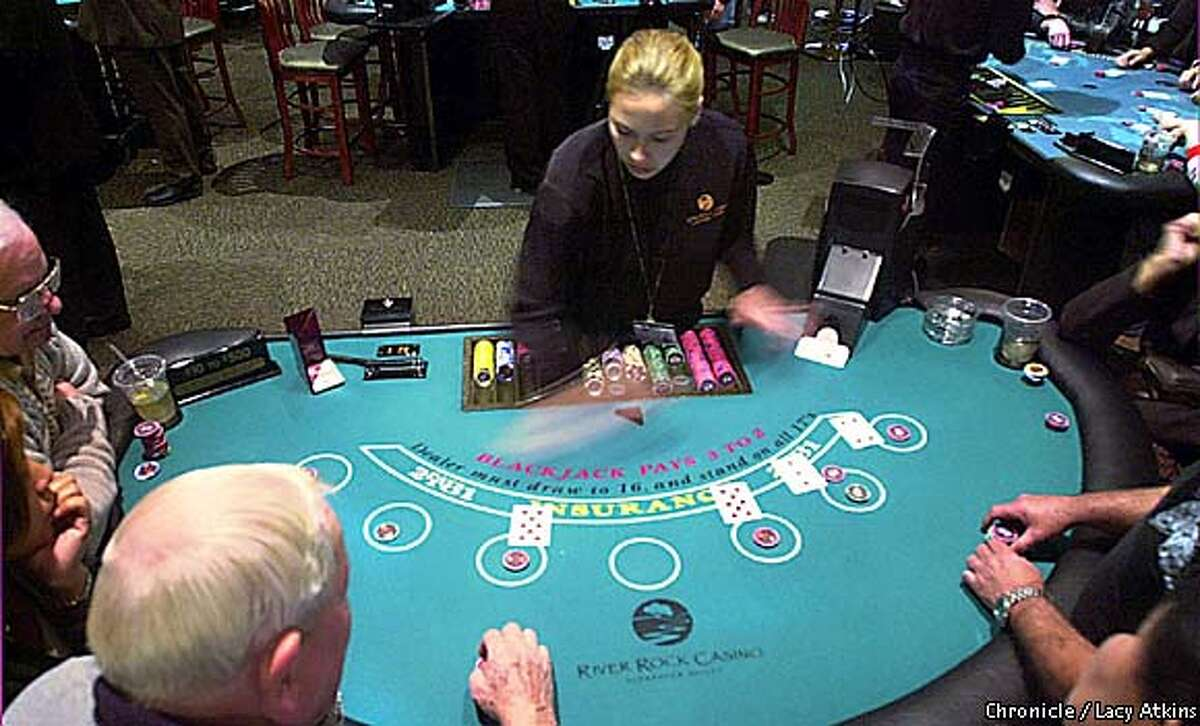 Dealer Lisa Kangas, deals a game on
