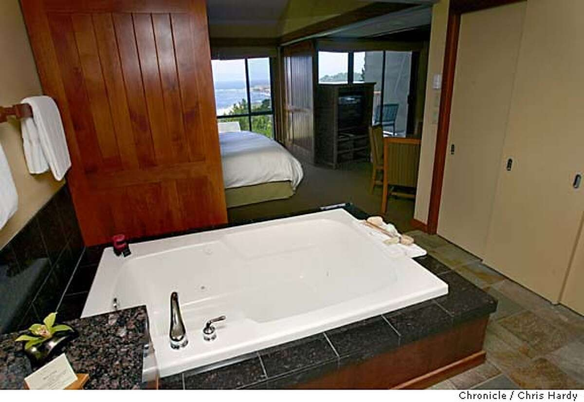 The Hyatt Highlands Inn with views of Point Lobos, the California Market restaurant, enormous in-room bathtub next to the bed; the room's wood-burning fireplace; and the mountain bikes (free to guests) by the valet stand. in Carmel Highlands 5/11/05 Chris Hardy / San Francisco Chronicle