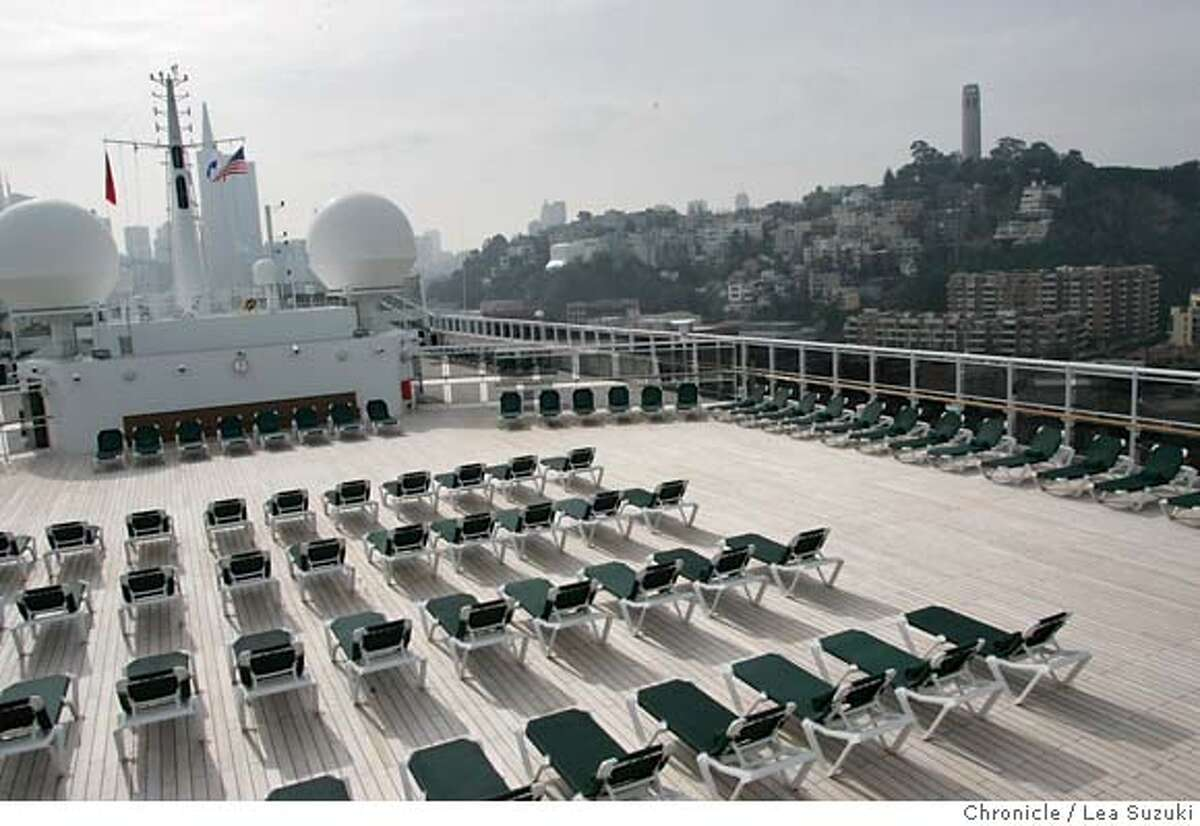 queen06_378_ls.jpg Top deck of the Queen Mary 2 with Coit Tower and the City in the background. Mayor Newsom trys a seat in the Commodore Club aboard the Queen Mary 2 before the Plaque and Key, a traditional ceremony when the boat comes into port, and Mayor Newsom's presenting of a proclomation. Media tours of the Queen Mary 2 and Mayor Newsom presents a proclomation to Captain Christopher Rynd on Monday, February 5, 2007. Photo by Lea Suzuki/The San Francisco Chronicle Photo taken on 2/5/07, in San Francisco, CA. **(themselves) cq. MANDATORY CREDIT FOR PHOTOG AND SAN FRANCISCO CHRONICLE/ -MAGS OUT