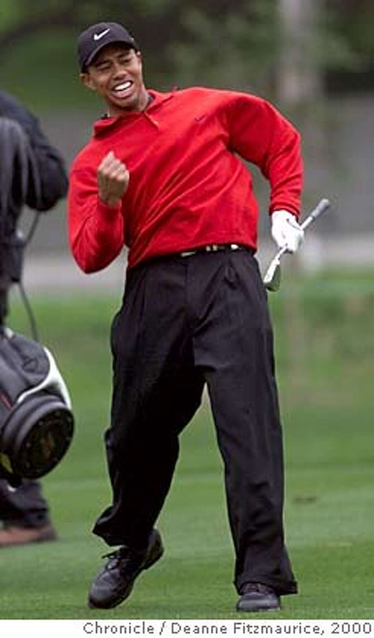 Tiger Woods reacts after holing a 97-yard wedge for an eagle on the 15th hole to lead the Pebble Beach National Pro-Am at Pebble Beach, Calif., February 7, 2000. Seven strokes behind with seven holes to play, Woods electrified an otherwise gray afternoon on the Monterey Peninsula with his comeback victory in the tournament. (AP Photo/The San Francisco Chronicle, Deanne Fitzmaurice) ALSO RAN: 01/31/2001, 03/27/03 (3-Star) CAT