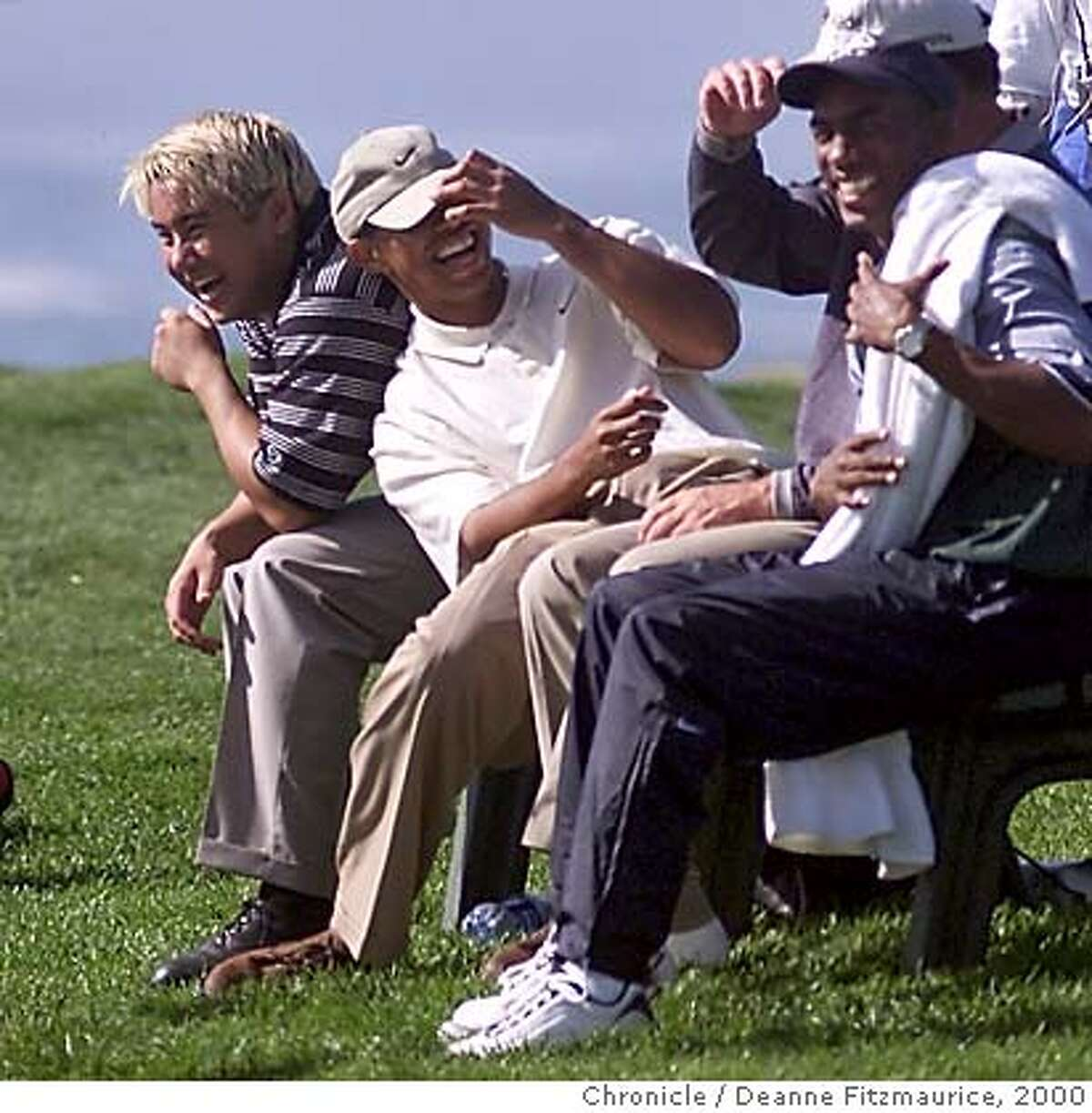 AT&T-TIGER2-C-06FEB00-SP-DF AT&T Pebble Beach National Pro-Am Championship at Pebble Beach Golf Course. Tiger Woods shares a laugh with teammate Jerry Chang (O'Meara is hidden) and a caddy as they sit on a bench at the 8th tee during a weather delay. CHRONICLE PHOTO BY DEANNE FITZMAURICE