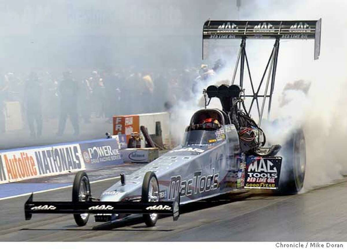 DKalitta.jc.jpg: Photo by JC Photo � Doug Kalitta topped Doug Herbert for his fifth win in Top Fuel at Infineon Raceway. Ran on: 08-01-2005 Doug Kalitta won his second straight and fifth overall championship at Infineon.