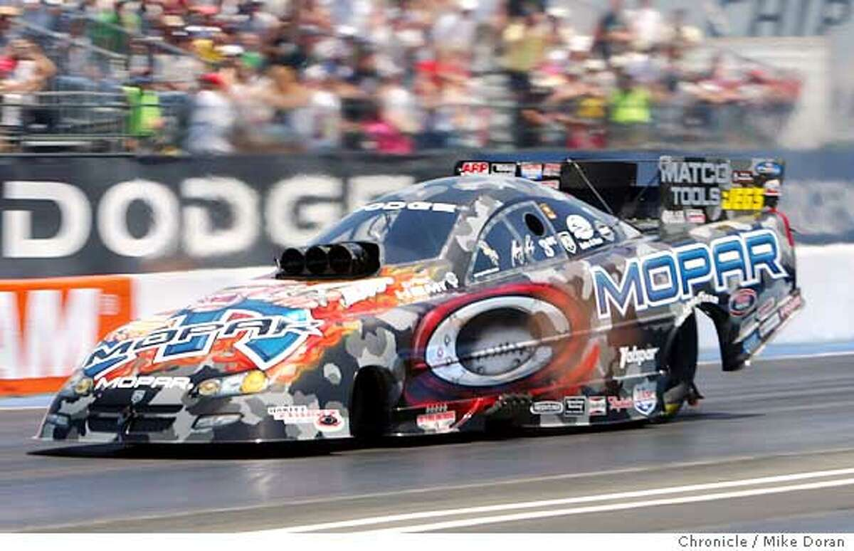 GScelzi.mdoran.jpg: Photo by Mike Doran � Fresno�s Gary Scelzi claimed his second Infineon Raceway Funny Car victory on Sunda Ran on: 08-01-2005 Doug Kalitta won his second straight and fifth overall championship at Infineon.