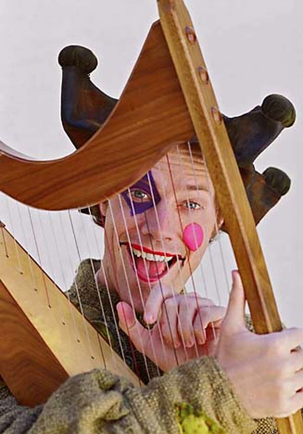 Michael Milligan as the jester Feste in Shakespeare Santa Cruz's 2005 production of Twelfth Night. Photo: R.R. Jones 55849