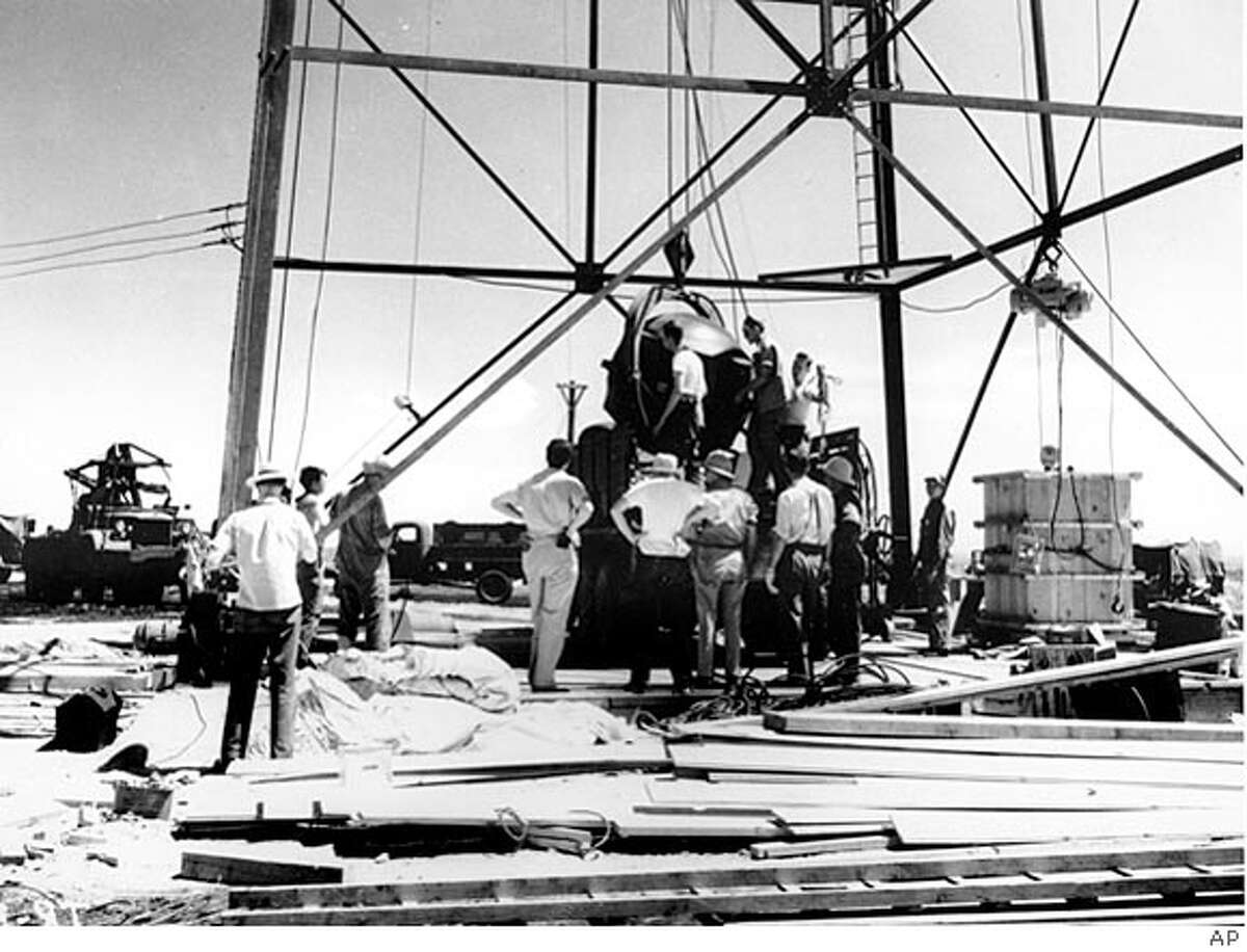 ** FILE ** Scientists and workmen rig the world's first atomic bomb to raise it up into a 100-foot tower at the Trinity Test Site in the desert near Alamagordo, N.M., in July 1945. The first atomic bomb test, known as the Manhattan Project, took place July 16, 1945. The Trinity Site generally is open to the public only twice a year, the first Saturday in April and October. This year, the site will be open for tours for the 60th anniversary, Saturday, July 16. (AP Photo/File) JULY 1945 FILE PHOTO