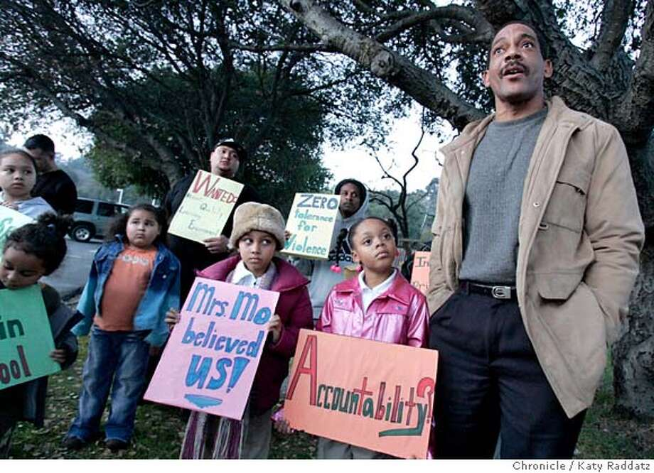 TEACHER06_044_RAD.jpg SHOWN: R: Harold Scoggins speaks in support of Jennie Mo. Harold's daughter, Tylisha Scoggins, age 7, a student of Jennie Mo's, stands beside him. A gathering of students and parents and teachers at Sheldon Elementary School in Richmond regarding Jennie Mo, the second grade teacher who was arrested. The gathering was mostly supportive of Ms. Mo.These pictures were made on Monday, Feb. 5, 2007, in Richmond, CA.  (Katy Raddatz/SF Chronicle) **Harold Scoggins, Tylisha Scoggins Mandatory credit for the photographer and the San Francisco Chronicle. ; mags out. Photo: Katy Raddatz
